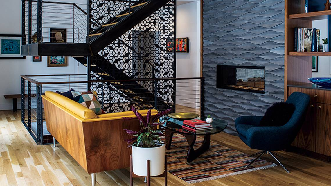 geometric cut outs adorn a central staircase in a Kansas City midcentury ranch