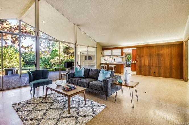 Long Beach Mid Century Modern living room with floor-to-ceiling windows and wood panelling
