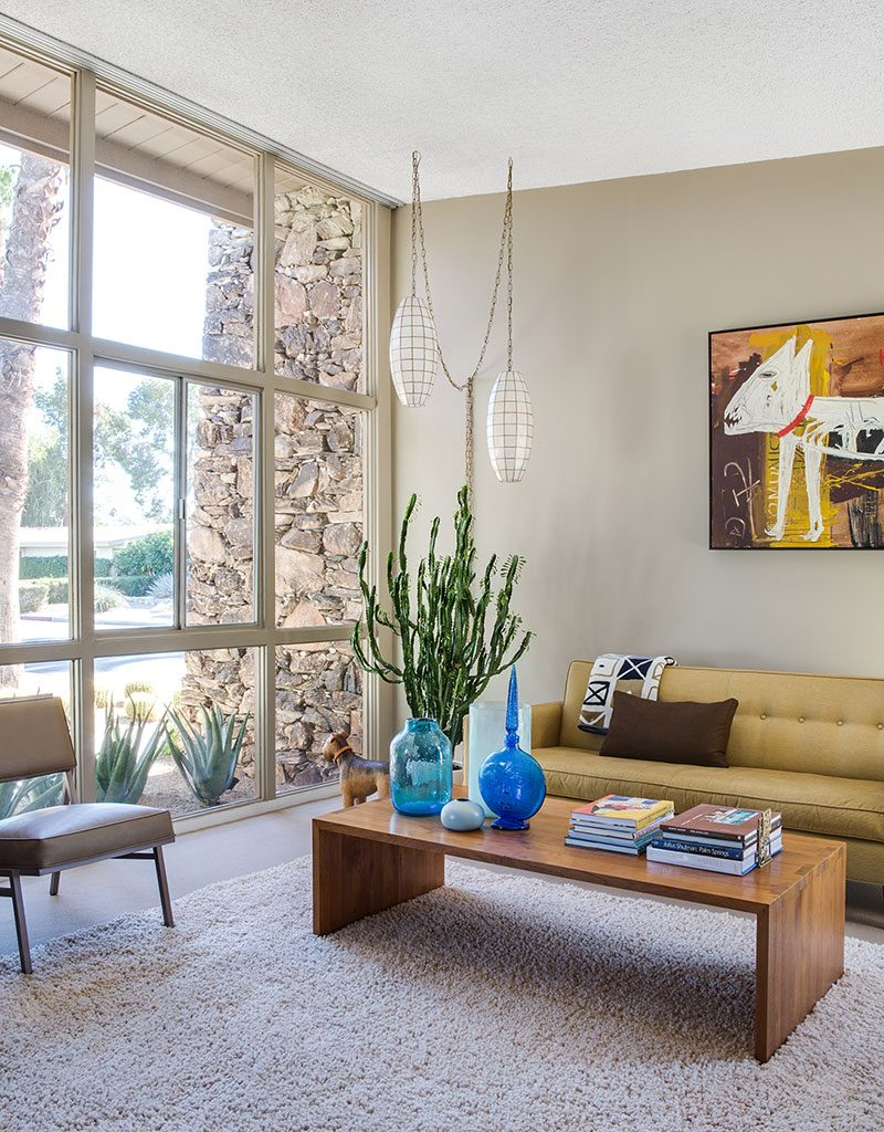 carpeted mid century modern living room with floor-to-ceiling windows