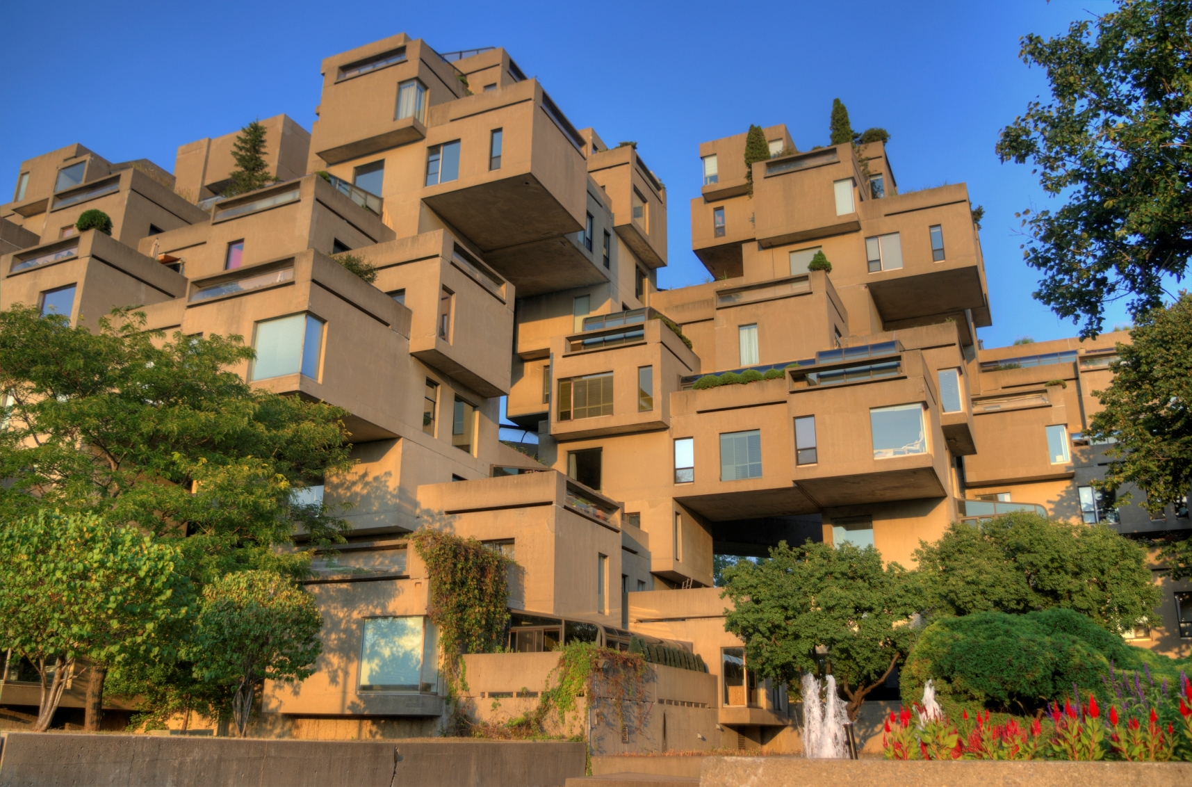 Apartment complex made out of many rectangular concrete rooms stacked on top of each other in uneven fashion.