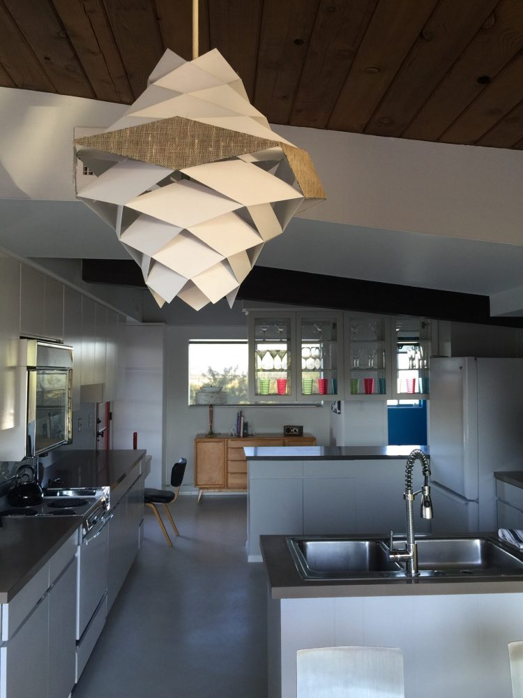 bright and airy kitchen with a light fixture in restored arthur t. brown home