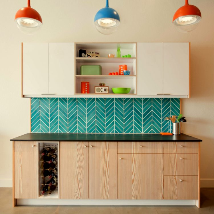 bright blue angular tile from modwalls in a colorful mid century modern kitchen