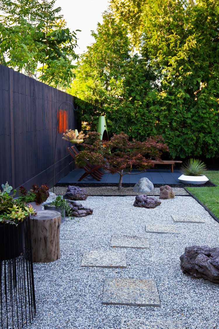 Mid Century Modern backyard landscaping with lava rocks