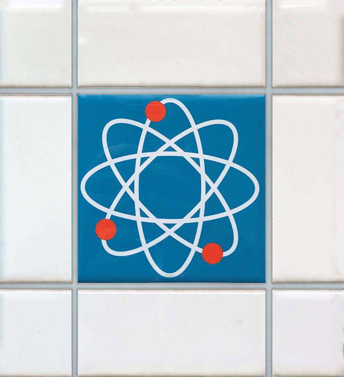 Blue mid century tile with atom design.