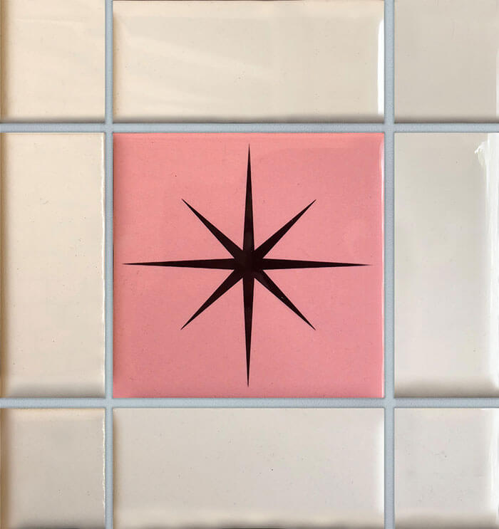 Pink mid century tile with starburst design.