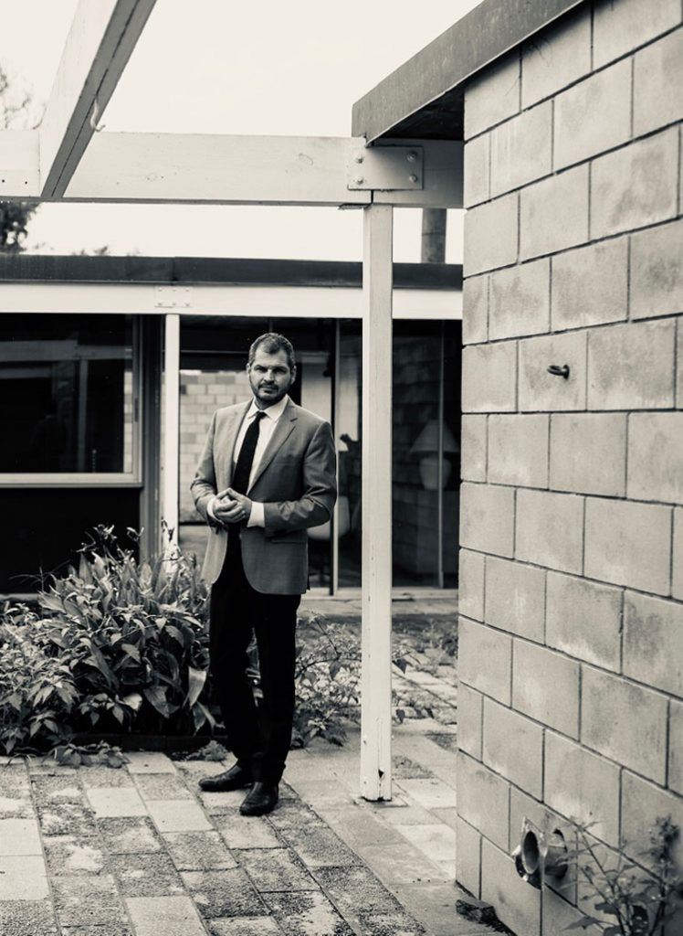 Max Strang FAIA in the courtyard of the Leedy Residence