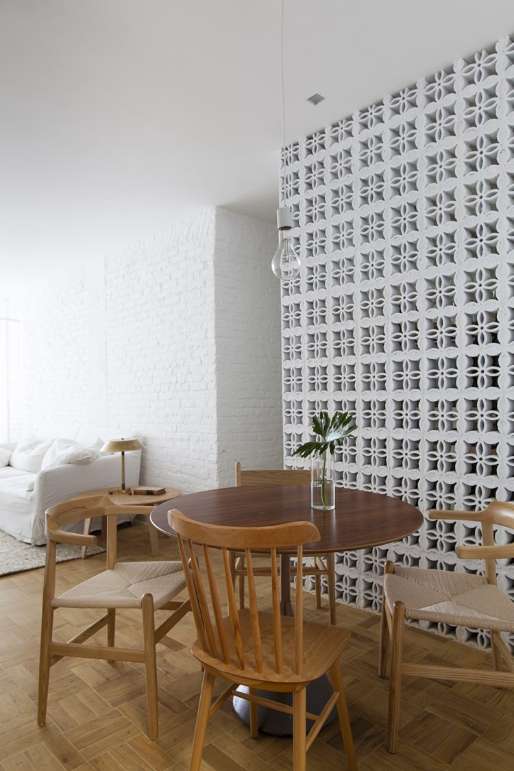 mid century modern dining room with breeze blocks wall