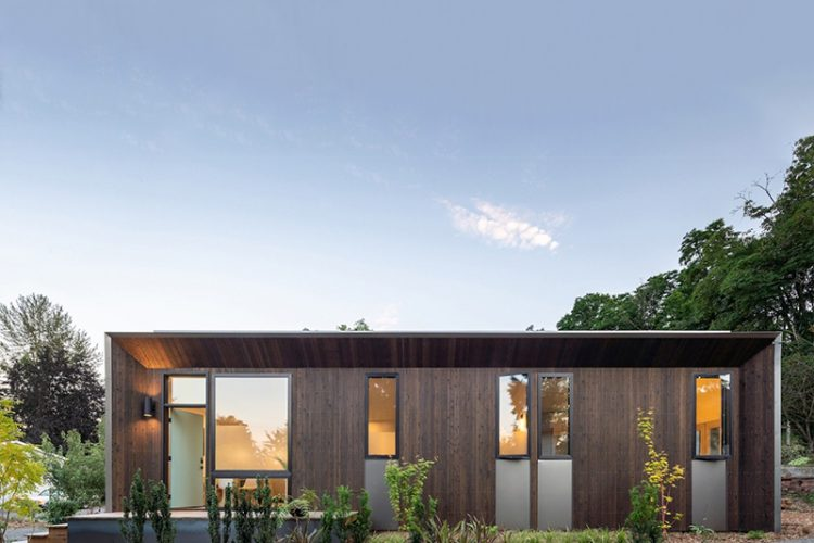 stylish pre-fab homes with windows and wood siding