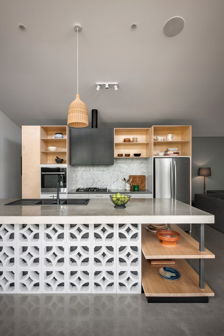 modern kitchen with breeze blocks on bottom half on kitchen island