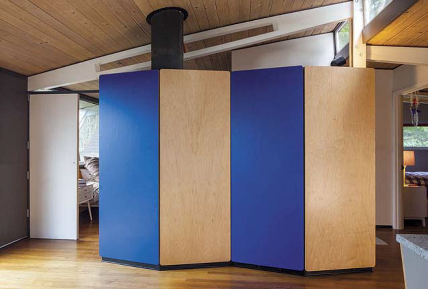 A blue laminate and plywood partition to separate a bedroom from the front room.