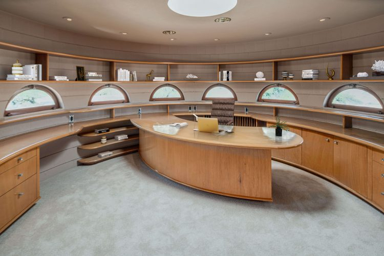 An office with half-moon windows to complement its oval shape.