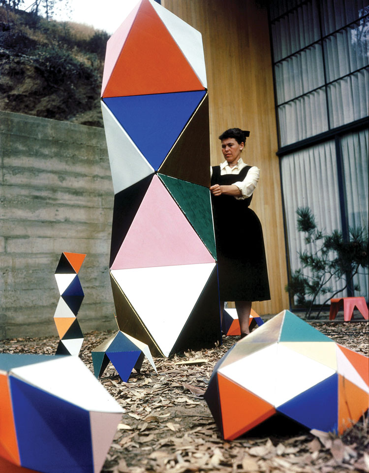 Ray Eames playing with a modernist geometric structure.