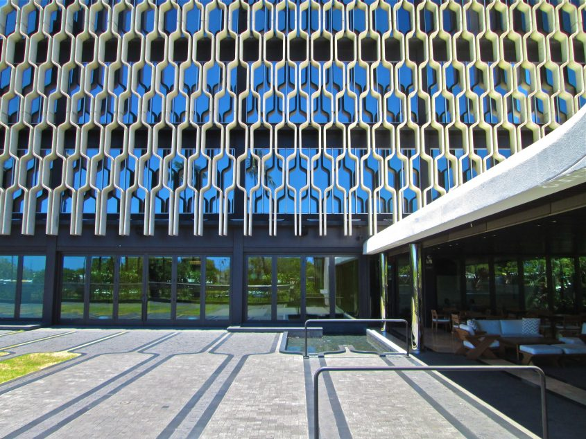 Closeup view of the honeycombed architecture surrounding the entire building.