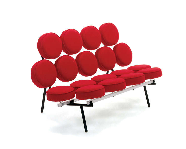 A Herman Miller red sofa composed of several circular cushions.