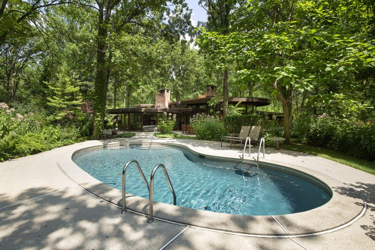 exterior of mid century illinois home with pool