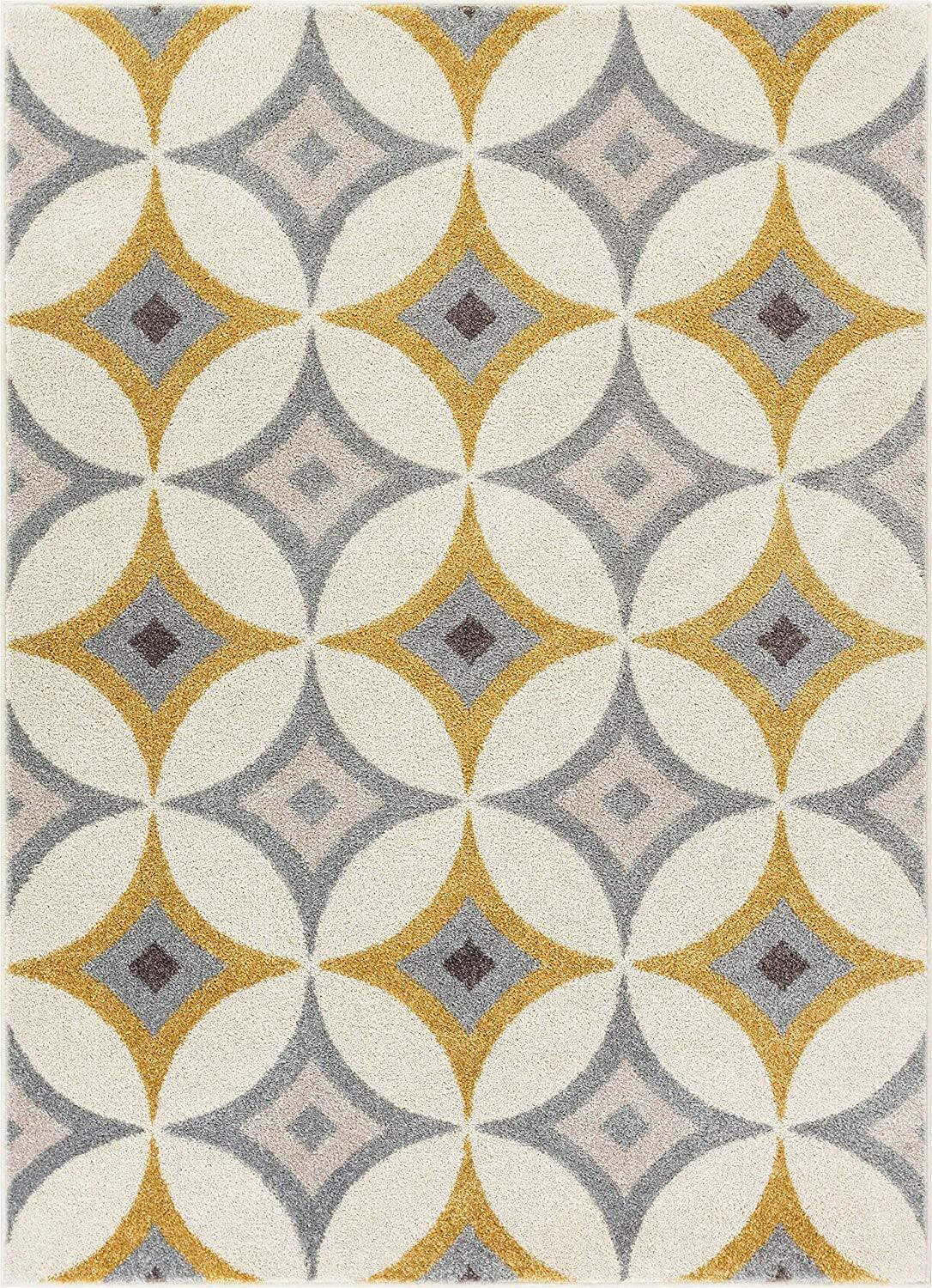 A mid-century rug with diamond shapes all over.