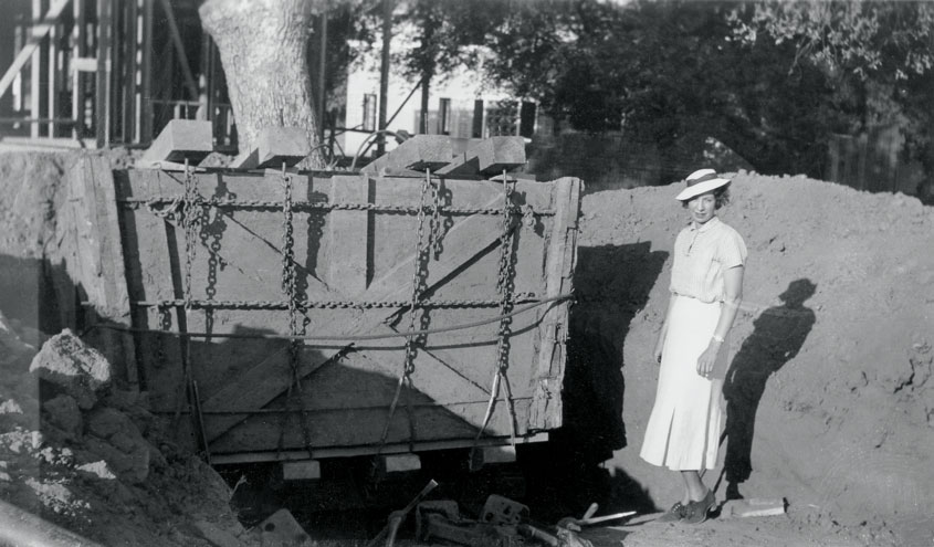 Ruth Shellhorn standing next to a building apparatus in the beginning stages of one of her projects.