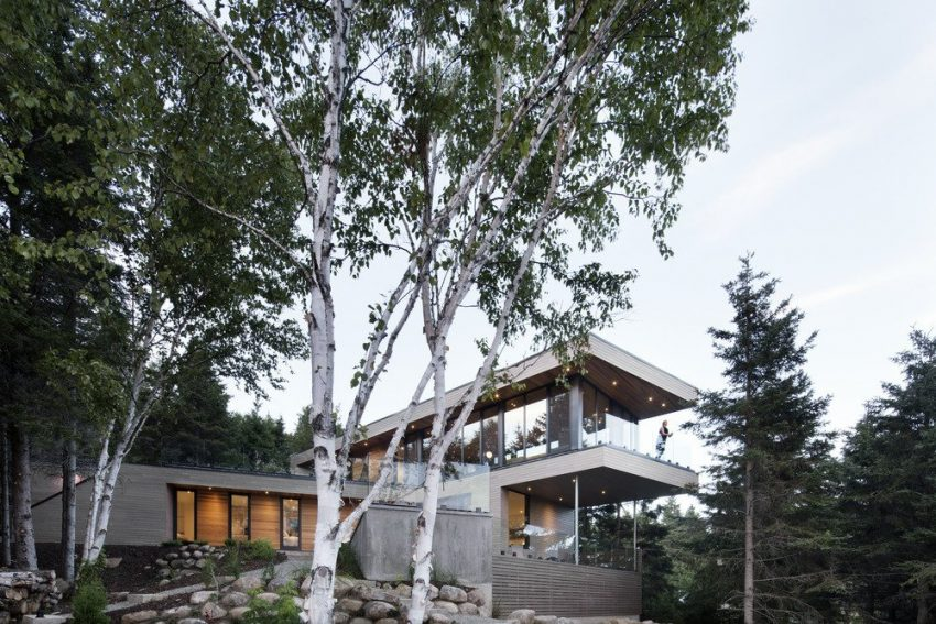 cantilever house in quebec forest