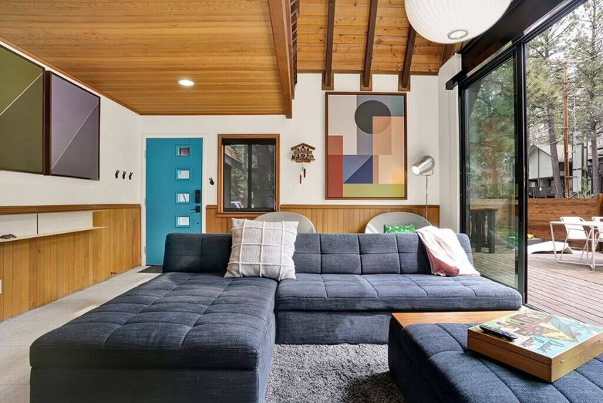 The A-frame cabin living room, showcasing a vintage cuckoo clock.