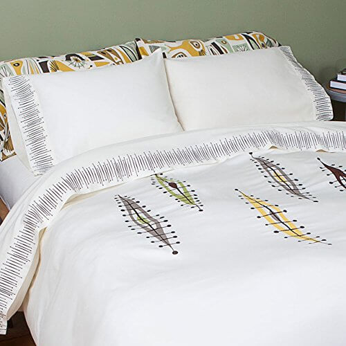 White mid century bedding with an abstract surfboard pattern.