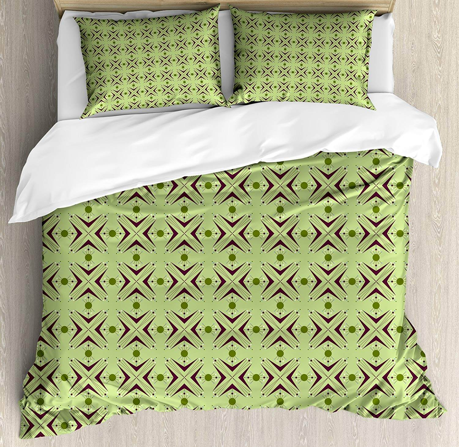 Green mid century modern bedding with a repeating geometric cross print.