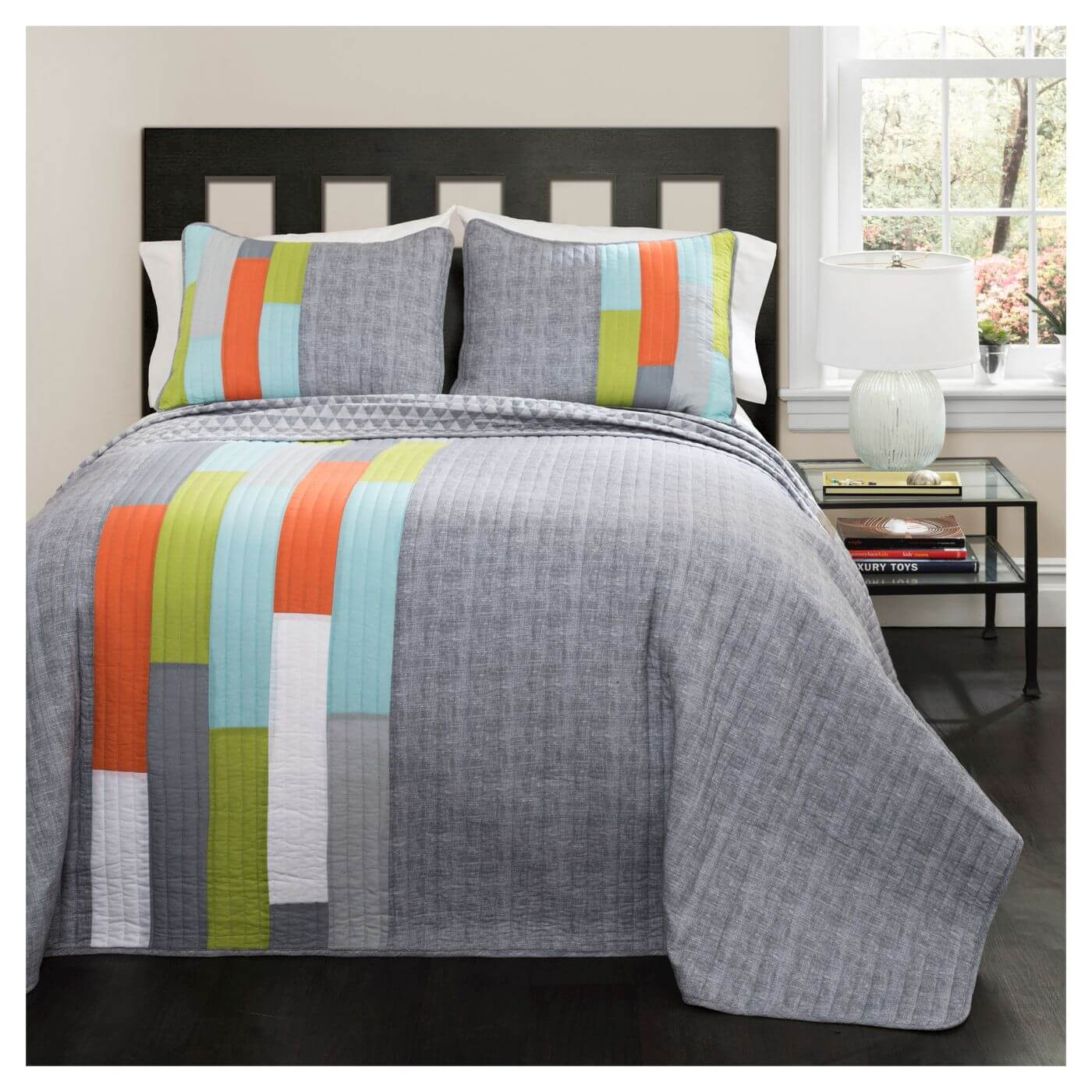 A gray quilt with orange, blue, and green stripe decals.