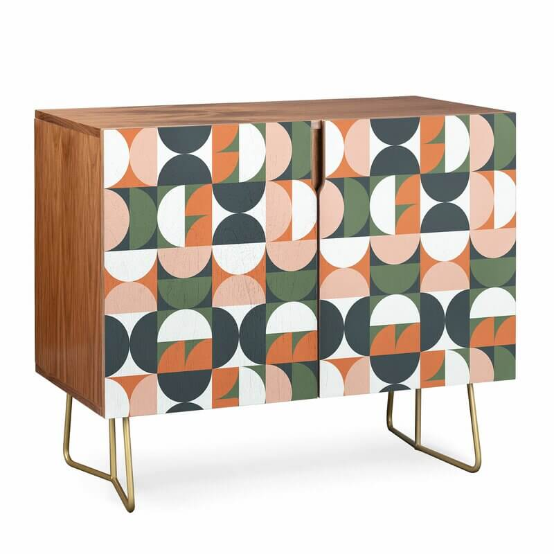 A mid century credenza with a multi-colored half circle design repeating over the facade.