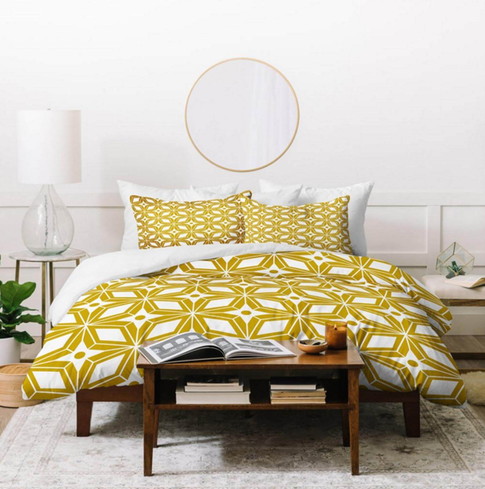 Mid century modern bedding with a yellow starburst print.