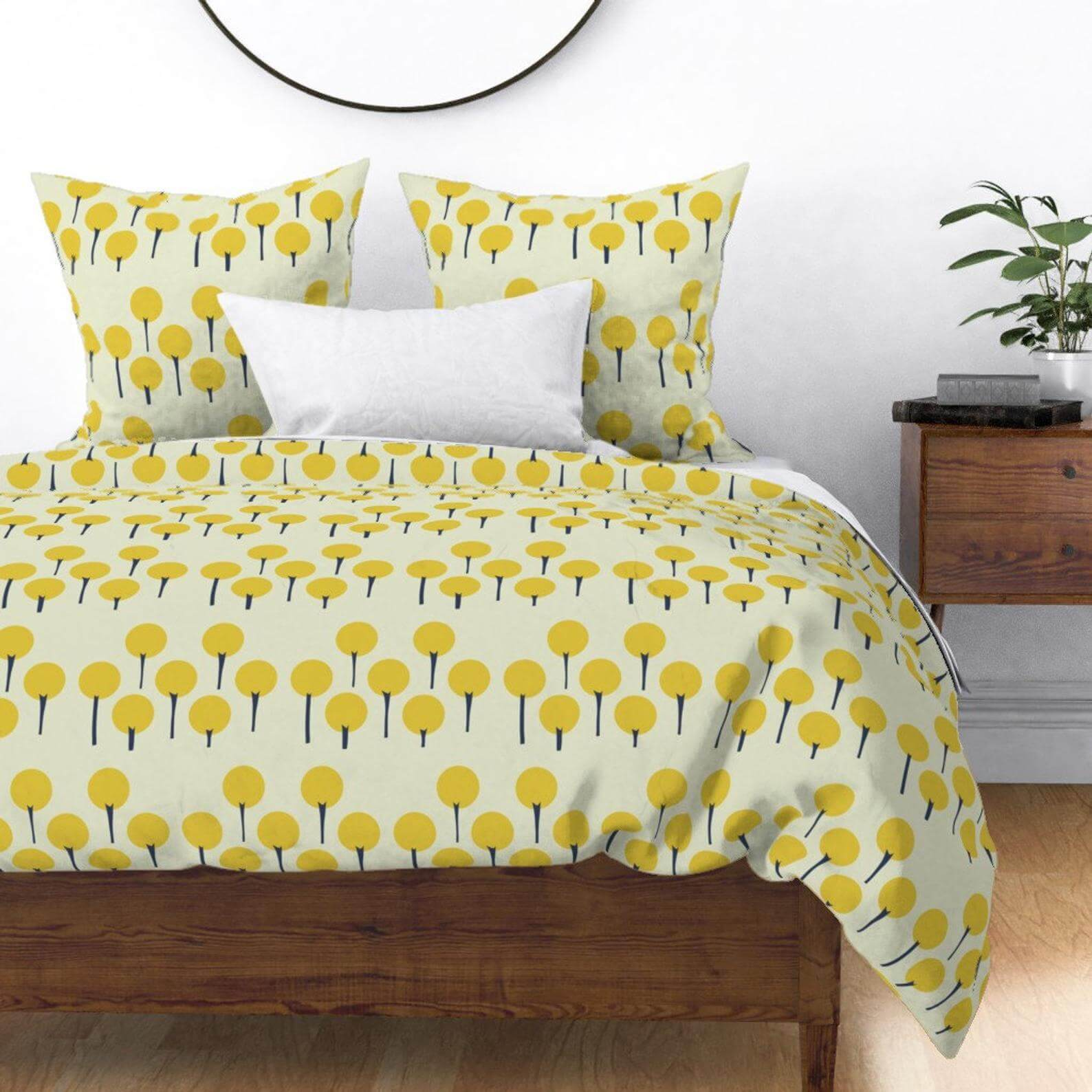 A duvet cover with a mid century tree pattern surrounding the exterior.