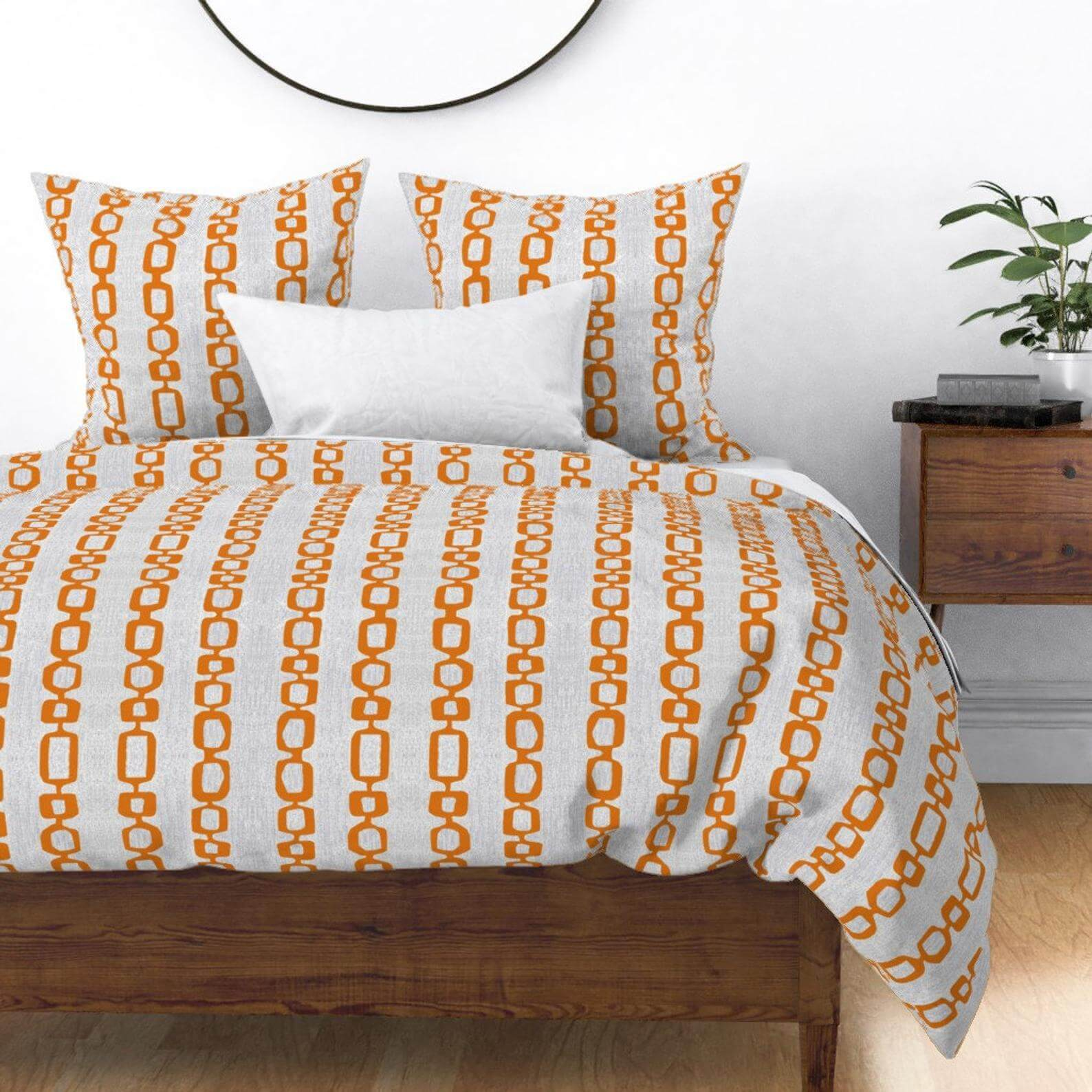 Gray-based mid century bedding with a orange link pattern.