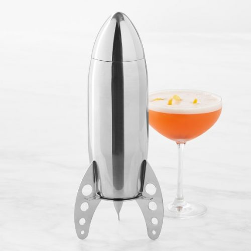 A mid mod barware cocktail shaker in a chrome-plated rocket ship design.