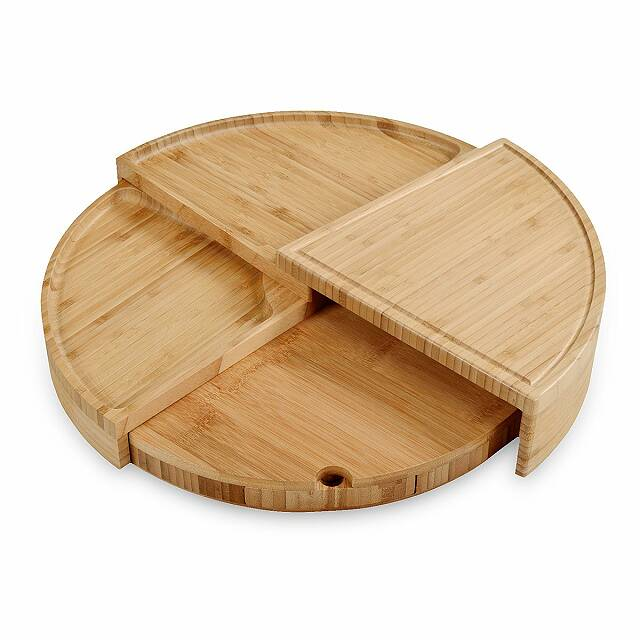 A wooden cheese board with multiple compartments.