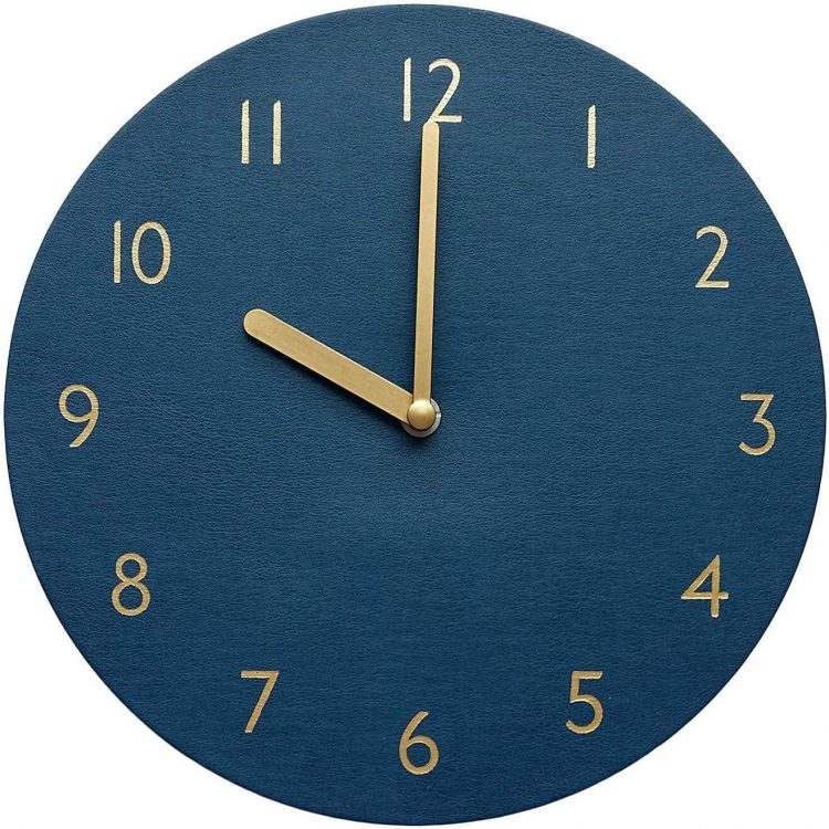 Classic blue wall clock with gold embellishments around the numbers and hands.