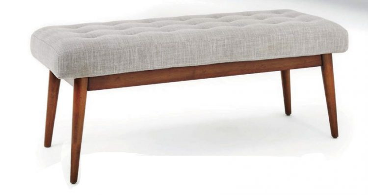 A mid century bench with a gray cushion and wooden-body frame.