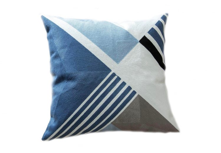 A geometric-faced pillow case in the color of the year, classic blue.