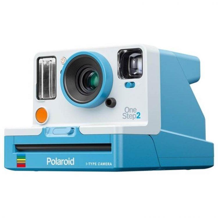 Mid mod entertaining blue polaroid camera.