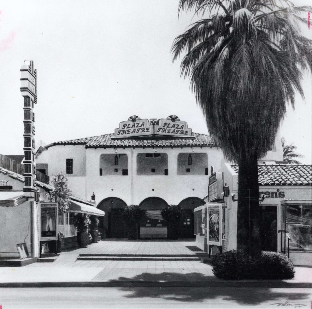 The exterior of the Plaza Theatre with a large Palm Tree positioned starkly next to the building.
