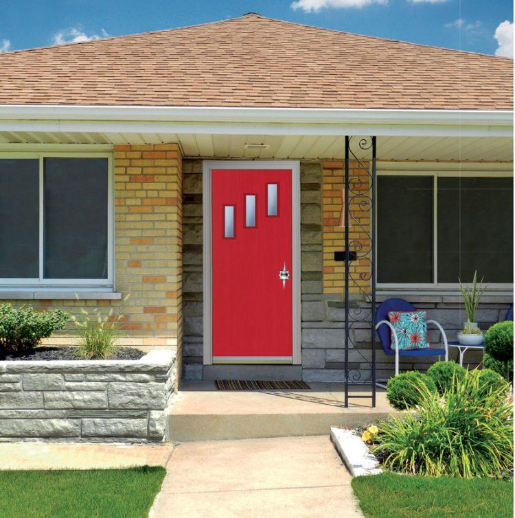 A home's red door with a triptych window and starburst door handle.