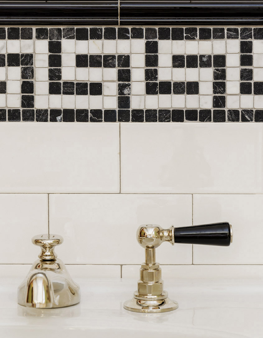 Mosaic tile glaze in a black and white zig-zagging pattern.