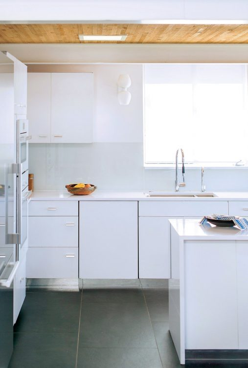 The kitchen's metal cabinets, finished in a white sheen.