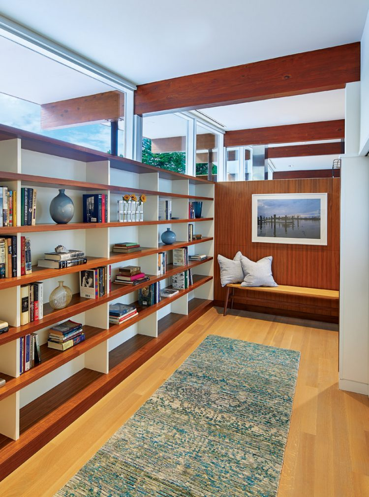 A mid century modern remodeled home featuring a collection of wood grain shelves in the master suite.