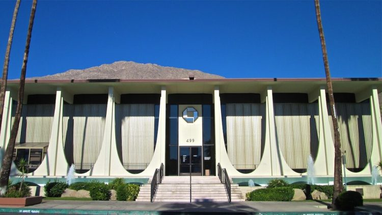 A googie-inspired bank with repeating parabolas, as in reference to the Palm Springs School of Architecture.
