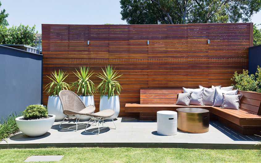 A personalized mid century modern patio with light and dark-toned mid century furniture.