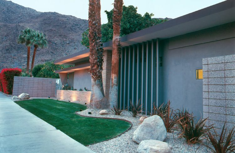 The Little Town and Desert Apartment Hotel with its green-beamed exterior in relation to the Palm Springs School of Architecture.