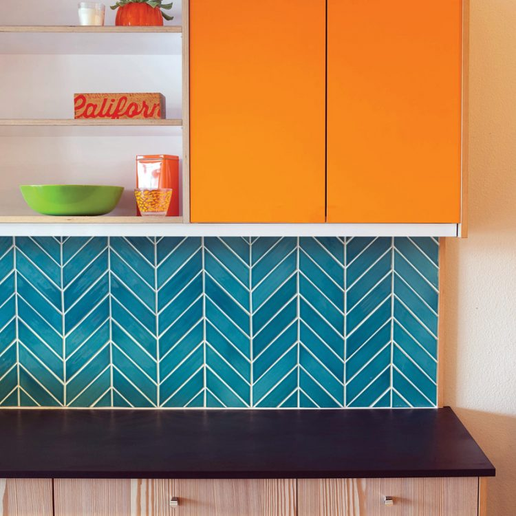 tile colors. Blue chevron tiling below an orange cabinet.