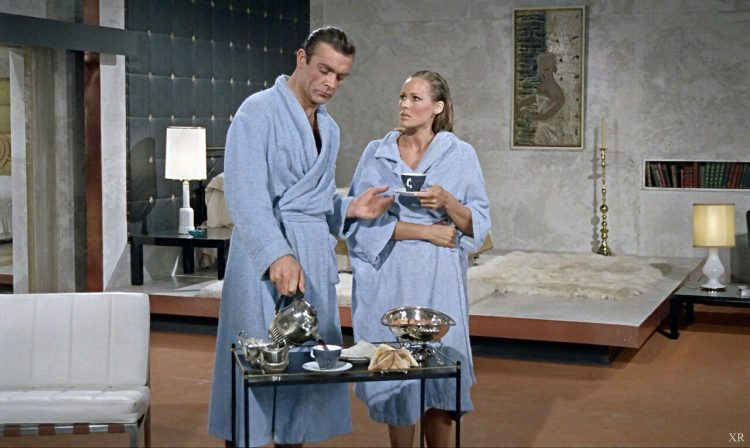James Bond and Ursula Andress in bathrobes.