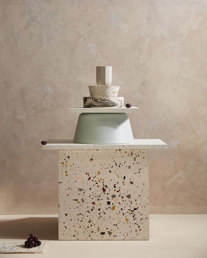 Terrazzo tile art piece with several different alternative recyclable materials.