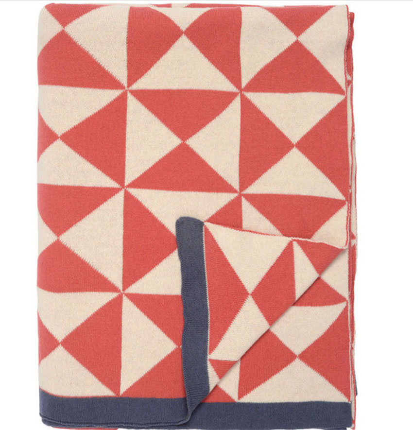 orange and cream geometric throw blanket with dark grey trim
