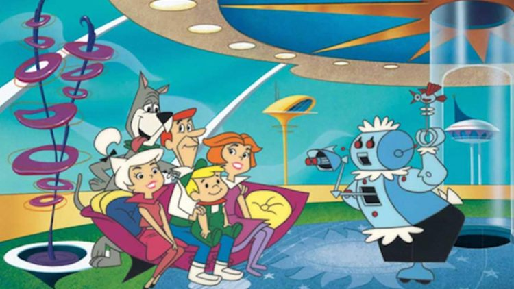 The Jetson family sitting on the couch in front of robot housekeeper.