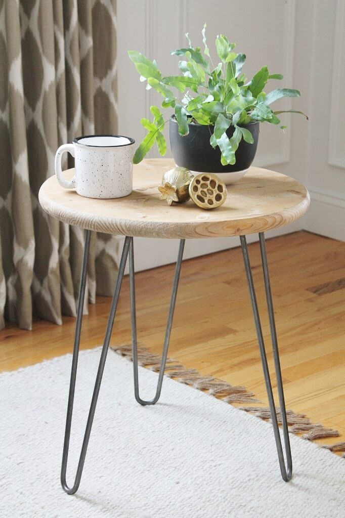 Hairpin side table with plant and coffee mug on top for mid century DIYs